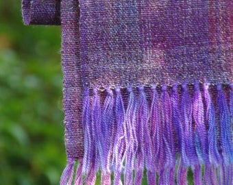 Hand woven merino wool and mulberry silk scarf, beautiful varigated plum and  violets in the hand dyed warp, and handspun silk merino.