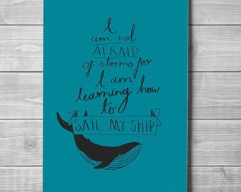 Hand drawn inspirational printed poster with blue whale & a Louisa M. Alcott quote 'I am not afraid of storms for I am learning how to sail'