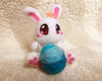 Needle felt Easter bunny. Handmade Easter bunny. Easter bunny with Easter egg. Wool felt doll. Gift for all age. Felted present.