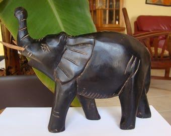 Wooden elephant Vintage Hand - Carved Wooden African Elephant, dark brown (chocolate brown), vintage wooden sculpture, figure, statue