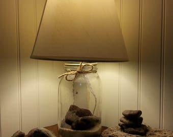 Maine made mason jar lamp with rhyolite stones hand picked from Jasper Beach in Machiasport, Maine