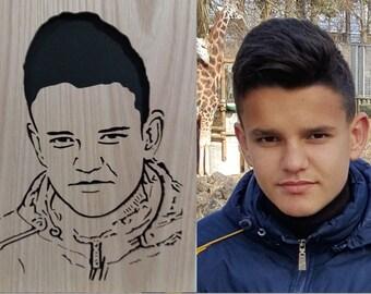Hand cut fretwork portrait of a young man.