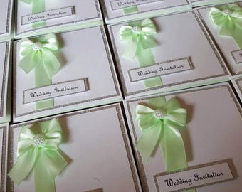 Lovely and Elegant Pearl Bow Wedding Invitation