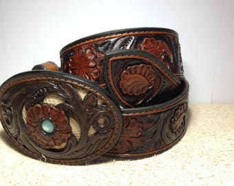 Leather belt with lizard inserts