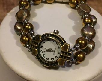 Golden magnetic wrist watch