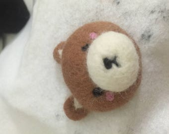 A cute wool felting bear brooch