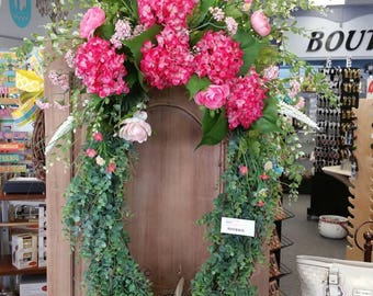 "24"" grapevine with greenery and hot pink hydrangeas."