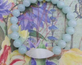 Bracelet and ear-rings of aquamarine and pearl