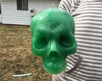 Green skull candle