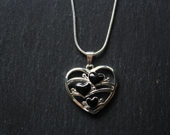 Heart pendant with 3 black enamel hearts