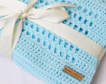 Handmade, aqua blue waffle baby blanket, ideal gift for a baby girl or boy for a baby shower. Versatile rectangle shape, pram blanket