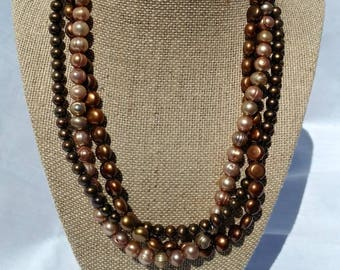 3 strand Freshwater Pearl necklace with matching earrings
