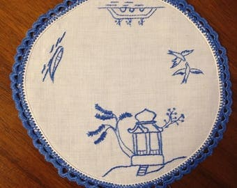 Vintage hand embroidered round doily, 20 cm, blue Japanese scenes