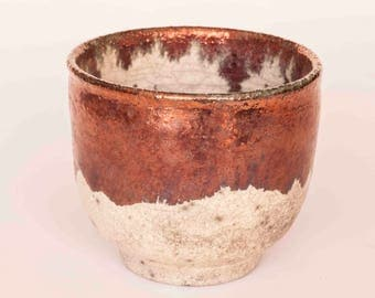 Cup of tea with copper lustre raku