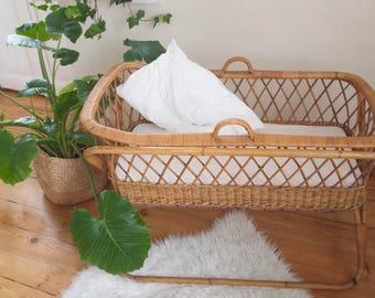 Vintage rattan bassinet