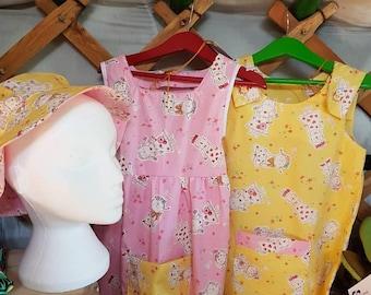 Girls summer dress and matching reversible hat.  Pink. Yellow