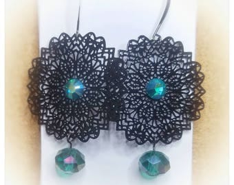 Round black filigree with crystals.