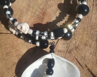 Boho hippy bracelet.  Glass and stone skull beads. 8 inch. Memory wire.