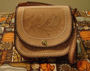 Hand made leather bag, with hand carved design, hand stitching and fully lined.