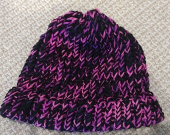 Black and pink knitted cap