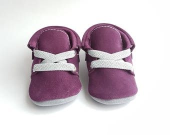 Baby moccasins purple.