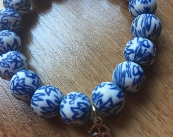 Clay Bead Bracelet with Hamsa Charm