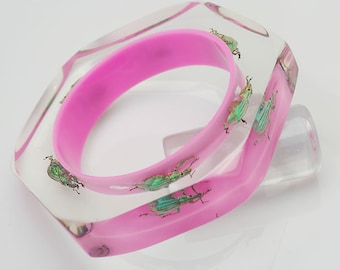 Faceted bright pink lucite bracelet with real glowing green beetles