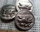 """Three .... Ducks in a Clog ... Vintage Pressed Metal Buttons. Measure just over 1 1/8""""."""
