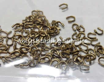 144 Pieces WIRE PROTECTORS 4MM (Antique Brass Plated)