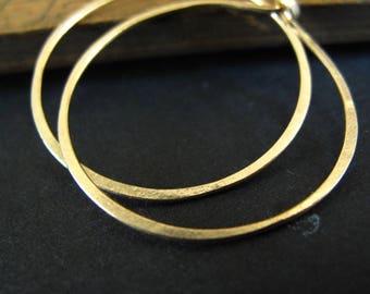 14k solid gold hoop earrings endless hoops rustic matte gold organic shape 1 inch