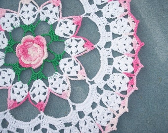 handmade thread crochet doily in white, shaded pink and green -- 1966