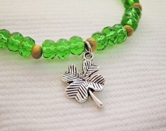 Lucky 4 leaf clover charm bracelet, green glass bead stretch bracelet, stacked jewelry, stackable bracelet, good luck four leaf clover