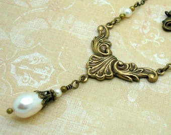 Neo Victorian Necklace with Cream Teardrop Swarovski Pearls and Rococo Brass Center