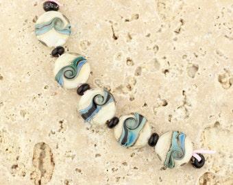 cosmic swirl, lampwork handmade glass beads