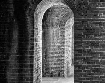 Arches Within Arches, black and white photograph, architectural photo, mysterious dark interior architecture photo, repeated brick arches