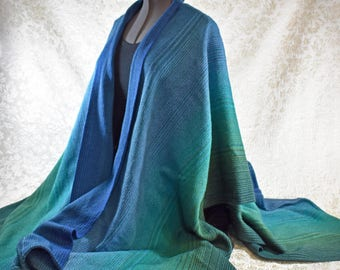 Hand woven, cotton ruana shawl, in a blue and green color blend,