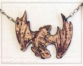 Fluttering Bat engraved alder wood pendant, long ear bat