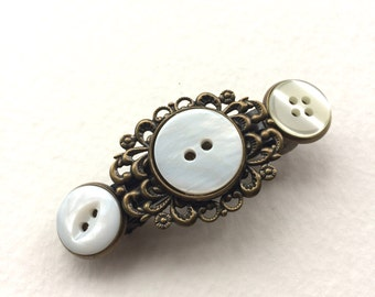White Buttons and antique brass Barrette