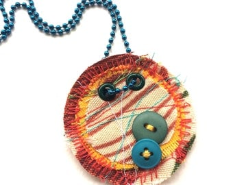 Orange Stitched Fabric with blue Buttons One of a kind Pendant Necklace