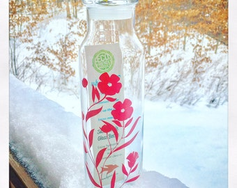 Reusable 22 oz. glass bottle with floral graphic