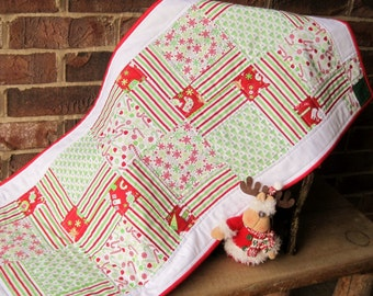 """Pieced, quilted table runner in classic holiday colors. Fabrics from Home for the Holidays Collection from Riley Blake Designs. 37"""" x 17.5""""."""