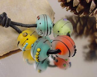 Handmade lampwork glass bead set, Artisan glass beads, yellow beads, blue beads, green beads, red beads, etched beads, SRA lampwork beads