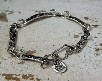 fine silver pierced bar and sterling link urban primitive bracelet