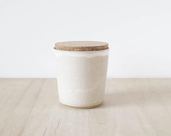 cork jar, cream.