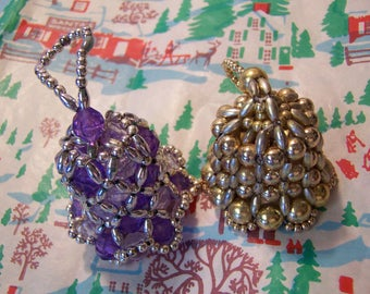 two beaded bell ornaments