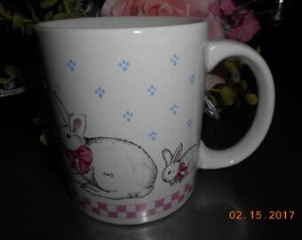 Vintage Porcelain Mug with Bunny Rabbits around it marked Made in Korea White Pink Blue Black