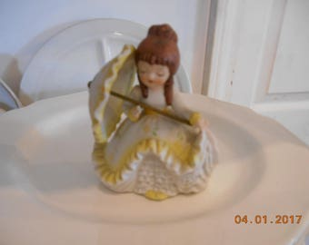Old Fashioned Girl with Umbrella Porcelain Figurine White and Yellow