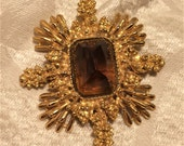 Vintage Heavy Gold Colored Brooch Pendant Combination with Brown Topaz Colored 1 Inch Stone. The Setting is About 3 by 2 1/2 Inches. (D7)