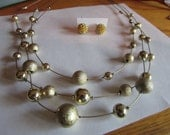 Gold illusion necklace
