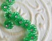 Vintage Buttons -  beautiful lot of 12 small matching style rhinestones set in acrylic. green flower design(mar134 17)